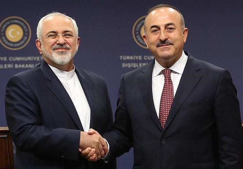 دیدار صمیمانه وزرای خارجه ایران و ترکیه در سنگاپور